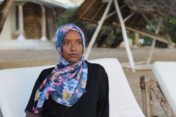 Woman wearing a scarf.