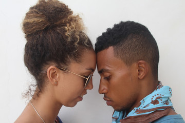 Close-up of young couple against white background
