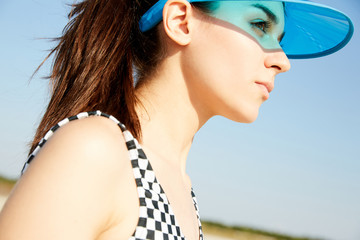 Closeup portrait of a young girl in blue visor Wall mural