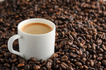 cup of coffee with crema espresso on background coffee