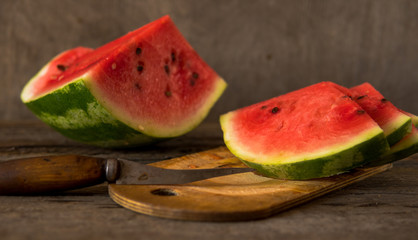 Watermelon slices on the woodan table. Fresh red watermelon. Rustical style.