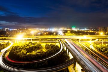 Fotomurales - road junction in midtown of modern city