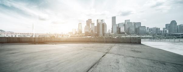 Fototapete - empty concrete floor with cityscape of modern city