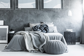 Monochromatic bedroom with pouf