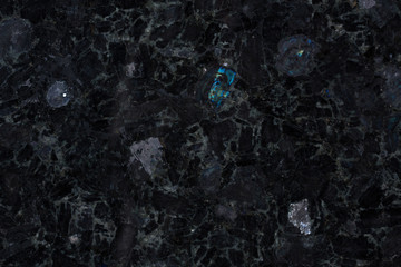 Fototapeten Marmor Close up of precious black labradorite stone.