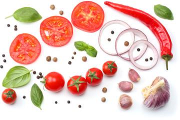 sliced red onion, red hot chili pepper, tomato, garlic and spices isolated on white background. top view