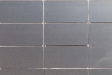 wall of grey ceramic tiles
