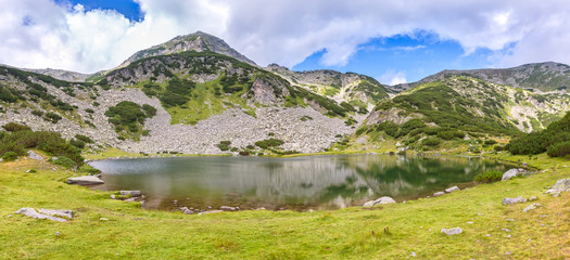 Pirin mountains / Magnificent summer panoramic view of the Muratovo lake in Pirin Mountains