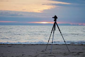 Camera on a tripod on the sea beach