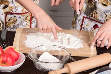 Fingers paint on flour