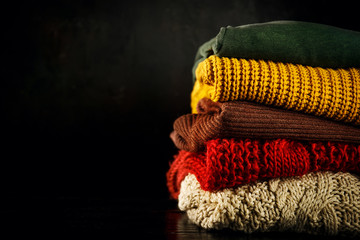 Knitted sweaters in heap