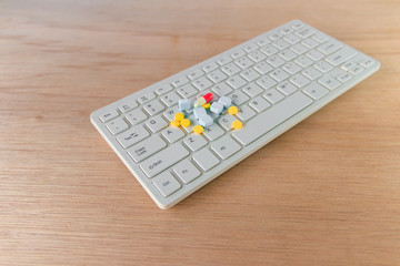 pills and capsule On computer keyboard Concept with copy space add text  ( high definition image )
