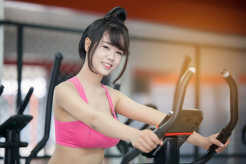 young woman exercise at the gym