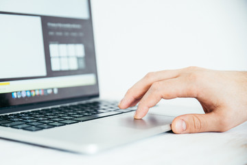 hand using touchpad on laptop