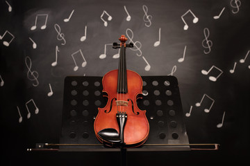 Violin and notes on blackboard
