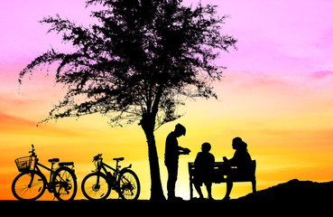Silhouette family happy  in holiday  on sunset time