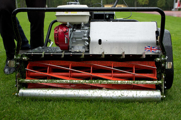 Spindle mower on the wet lawn