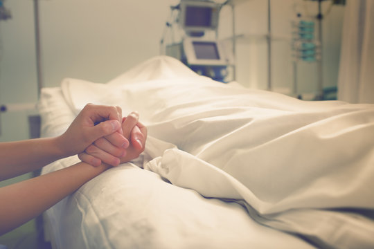 Woman mourns her husband, who died in a hospital