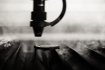 Industrial laser engraving on a paperboard engineering factory,