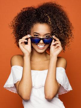 Beautiful black woman smiling and wear sunglasses