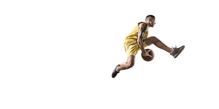 Basketball player makes slam dunk. Isolated basketball player on a white background. Player wears unbranded clothes.