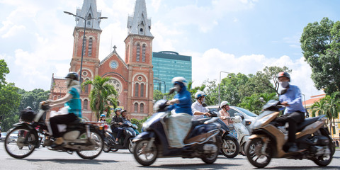 Motorcycles and Notre-Dame Cathedral in Saigon, Vietnam ホーチミンを走るバイクとノートルダム大聖堂