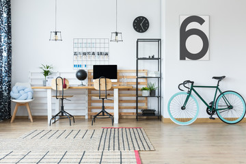 Spacious workspace with bike