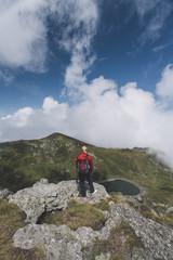 A women hiker standing on a peak