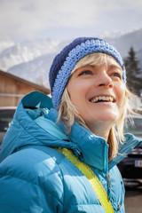Happy woman in warm clothing at alps