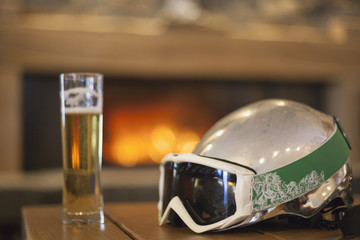 Beer after skiing in front of fireplace
