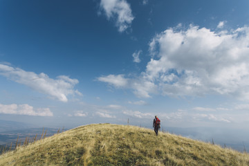 Woman walking on a mountain