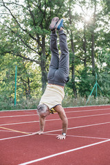 Man Doing Handstand on the Racetrack