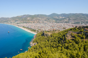 View from the mountain to the sea bay with blue water and to the city