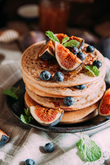 Delicious breakfast. Homemade pancakes with fresh figs and bluberries