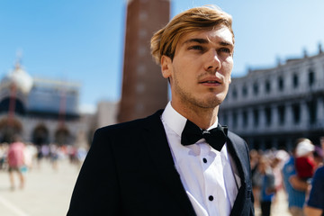 Elegant Young Man Walking in Venice Italy