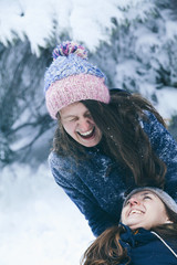 Female couple enjoying snowball fight