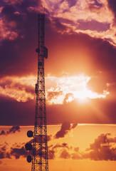 Telecommunication tower during dramatic sunrise