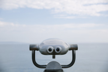 Binoculars overlooking the ocean