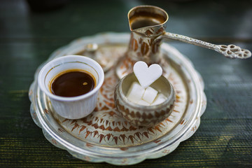 Traditional bosnian coffee on a green table