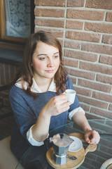 young woman having coffee