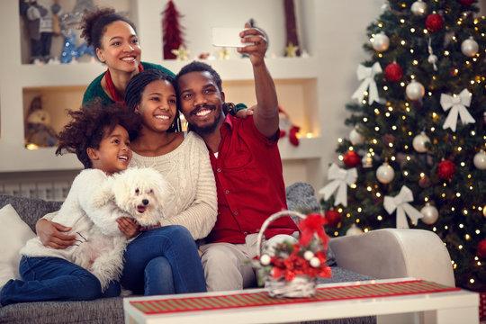Christmas selfie - Afro American family making selfie.