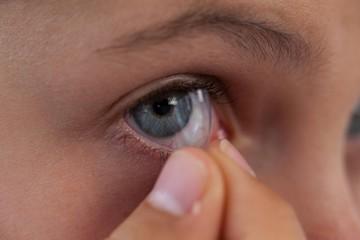 Girl wearing lenses against white background