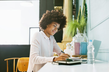 African american woman working in office.