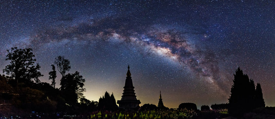 Panorama view of Milky way on top of King and Queen Pagodas at Doi Inthanon National Park, Chiang Mai, Thailand..