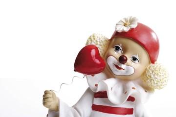 Little clown figurine and heart