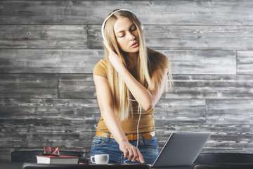 Beautiful woman DJ ing at workplace