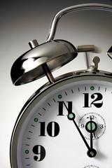 Alarm clock showing five-to-twelve