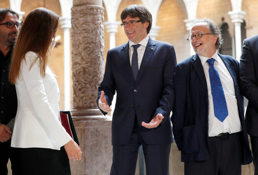 Catalan President Carles Puigdemont meets with members of the Independent Comission for Mediation and Dialogue in Barcelona