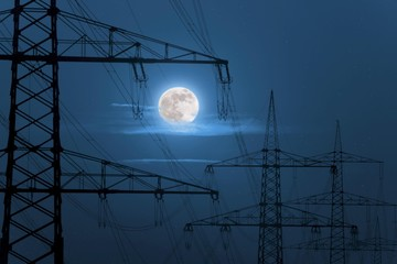 Power masts in the moonlight