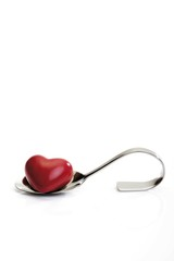 The way to a man's heart is through his stomach, spoon holding heart